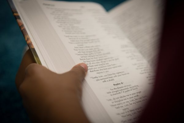 Guelph Christian School Student holding a Bible